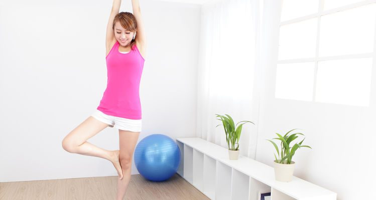 portrait of healthy young woman doing yoga at home in the morning, asian beauty